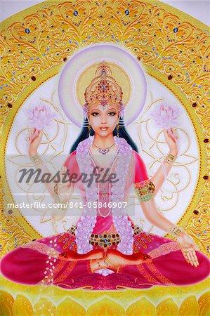 Picture of Lakshmi, goddess of wealth and consort of Lord Vishnu, sitting holding lotus flowers, Haridwar, Uttarakhand, India, Asia