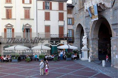 Cafe and statue, Piazza Vecchia, Bergamo, Lombardy, Italy, Europe