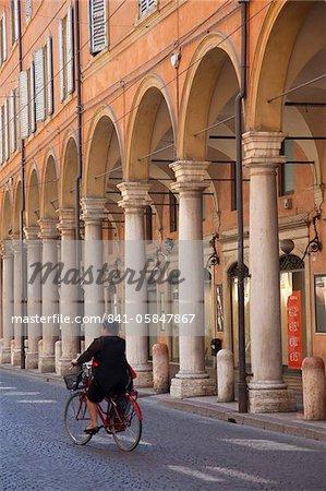 Arcade arches and cyclist, Modena, Emilia Romagna, Italy, Europe