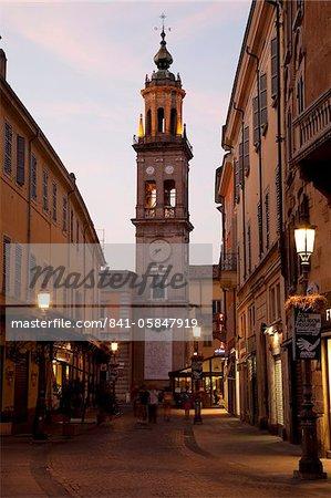 Church and street scene at dusk, Parma, Emilia Romagna, Italy, Europe