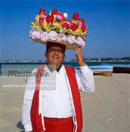 Flower seller on the beach, Hammamet, Cap Bon, Tunisia, North Africa, Africa