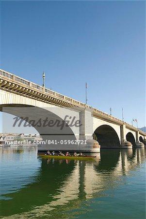 Paddlers enjoying the morning beneath London Bridge, Havasu, Arizona, United States of America, North America
