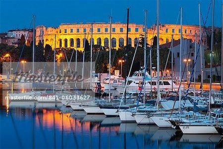 Dusk over marina and the Roman Amphitheatre, Pula, Istria, Croatia, Adriatic, Europe