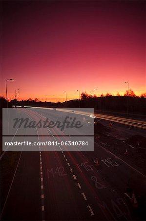 Roadworks and lane closures on the M5 Motorway at dusk, near Birmingham, West Midlands, England, UK, Europe.