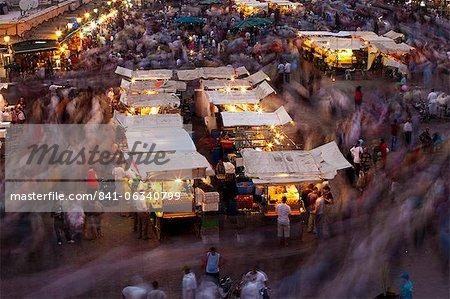 Long exposure, people moving around Djemaa El Fna, Marrakech, Morocco, North Africa, Africa