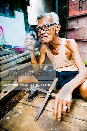 Portrait of an Indonesian carpenter man at Taman Sari, Water Castle, Yogyakarta, Central Java, Indonesia, Southeast Asia, Asia