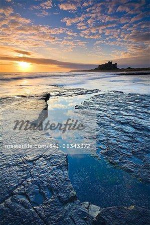 Bamburgh Castle and coastal landscape at sunrise, Bamburgh, Northumberland, England, United Kingdom, Europe