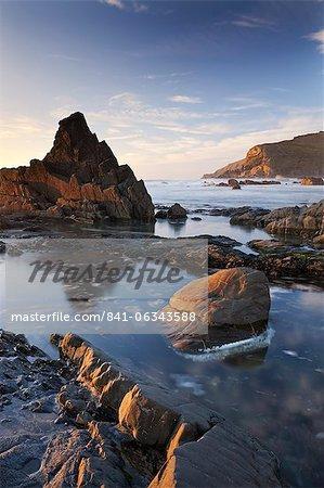 Rockpools and jagged rocks at Duckpool beach in North Cornwall, England, United Kingdom, Europe