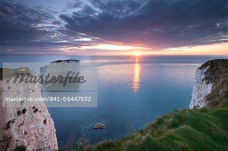 Sunrise over Old Harry Rocks, Jurassic Coast, UNESCO World Heritage Site, Dorset, England, United Kingdom, Europe