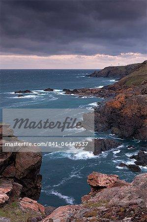 The Cornish coast at Trewellard Zawn looking towards Pendeen Lighthouse, Cornwall, England, United Kingdom, Europe