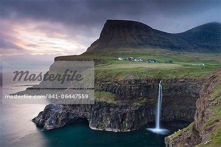 Dramatic coastal scenery at Gasadalur on the island of Vagar, Faroe Islands, Denmark, Europe
