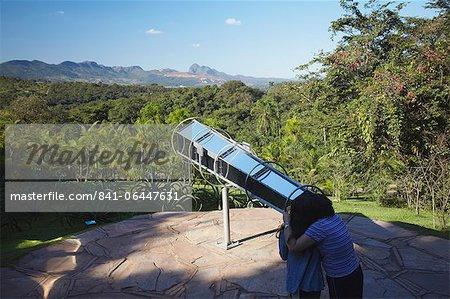 Couple looking though telescope by Olafur Eliasson at Centro de Arte Contemporanea Inhotim, Brumadinho, Belo Horizonte, Minas Gerais, Brazil, South America