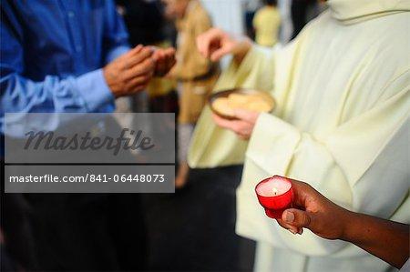 Catholic priest giving Holy Communion, Paris, France, Europe