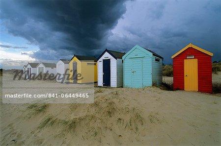 Beach huts under stormy sky, Southwold, Suffolk, England, United Kingdom, Europe