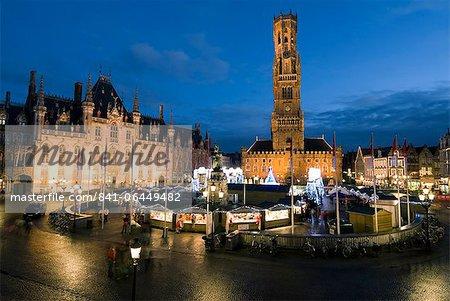Christmas Market in the Market Square with Belfry behind, Bruges, West Vlaanderen (Flanders), Belgium, Europe