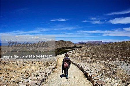 Walking down the path to the centre of the island, Isla del Sol, Lake Titicaca, Bolivia, South America