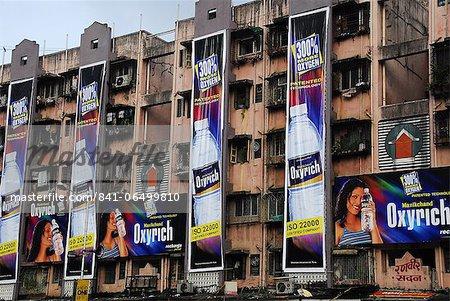 Advertisements on apartment buildings of Mumbai, Maharashtra, India, Asia