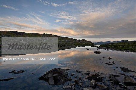 Alpine tarn at dawn, San Juan National Forest, Colorado, United States of America, North America