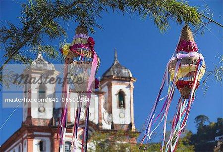 Decorations for festival with Our Lady of Conceicao de Antonio Dias Church in background, Ouro Preto, UNESCO World Heritage Site, Minas Gerais, Brazil, South America