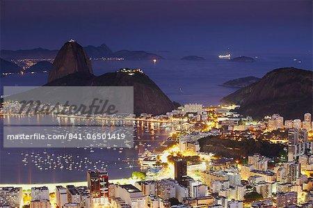 View of Sugar Loaf Mountain (Pao de Acucar) and Botafogo Bay at dusk, Rio de Janeiro, Brazil, South America