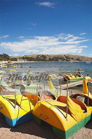 Pedaloes on beach, Copacabana, Lake Titicaca, Bolivia, South America