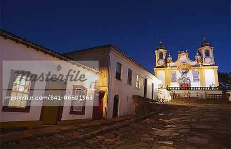 Colonial houses and Matriz de Santo Antonio Church at dusk, Tiradentes, Minas Gerais, Brazil, South America