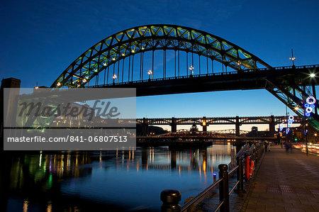 Gateshead Quays with Tyne Bridge and River Tyne swing bridge at night, Tyne and Wear, England, United Kingdom, Europe