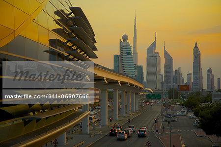 City skyline and Metro Station at sunset, Dubai, United Arab Emirates, Middle East
