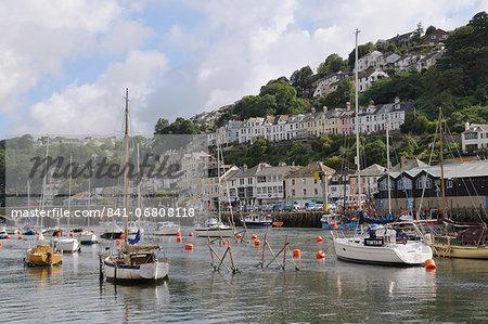 Sailing yachts, pleasure boats and fishing boats moored in Looe harbour, Cornwall, England, United Kingdom, Europe