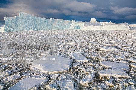 Huge iceberg amongst sea ice near Petermann Island, western side of the Antarctic Peninsula, Southern Ocean, Polar Regions