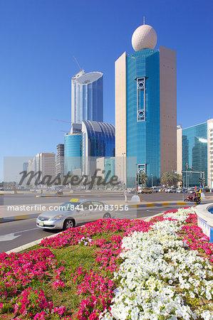 Contemporary architecture and taxi on Rashid Bin Saeed Al Maktoum Street, Abu Dhabi, United Arab Emirates, Middle East