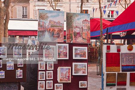 Paintings on sale at the famous Place du Tertre in Montmartre, Paris, France, Europe