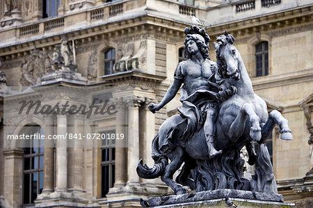 Statue of Louis XIV outside Louvre Museum, Paris, France