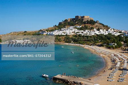 Acropolis and village, Lindos beach. Lindos, Rhodes, Dodecanese, Greek Islands, Greece, Europe