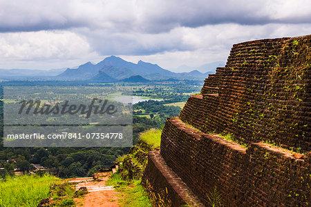 Ruins of King Kassapa's Palace in front of the view from of Sigiriya Rock Fortress (Lion Rock), UNESCO World Heritage Site, Sigiriya, Sri Lanka, Asia