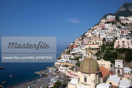 View of Positano with the typical majolica dome of Santa Maria Assunta, Costiera Amalfitana, UNESCO World Heritage Site, Campania, Italy, Europe