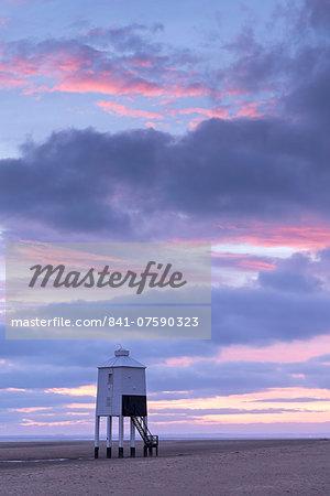 Sunset beyond wooden lighthouse at Burnham-on-Sea, Somerset, England, United Kingdom, Europe