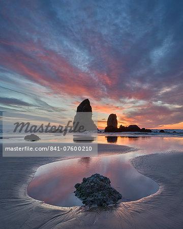 Sea stacks at sunset, Cannon Beach, Oregon, United States of America, North America
