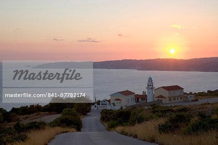 Sunset over Lourdata Bay, monastery prominent, near Lourdata, Kefalonia (Kefallonia, Cephalonia), Ionian Islands, Greek Islands, Greece, Europe