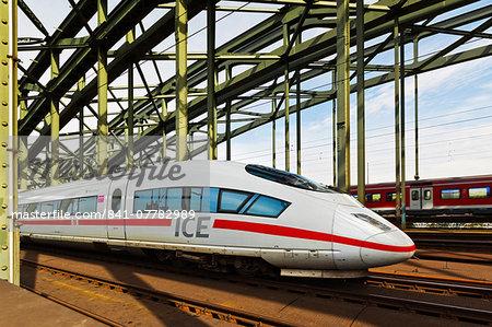 Intercity-Express ICE train, fastest on the network, on Hohenzollern railway bridge, Cologne, North Rhine-Westphalia, Germany, Europe