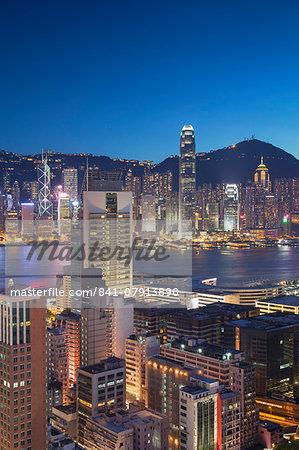 View of Hong Kong Island and Tsim Sha Tsui skylines at dusk, Hong Kong, China, Asia