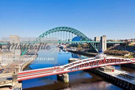 Newcastle upon Tyne city with Tyne Bridge and Swing Bridge over River Tyne, Gateshead, Tyne and Wear, England, United Kingdom, Europe