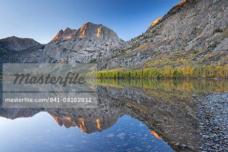 Carson Peak reflected in Silver Lake at dawn, June Lake Loop, California, United States of America, North America