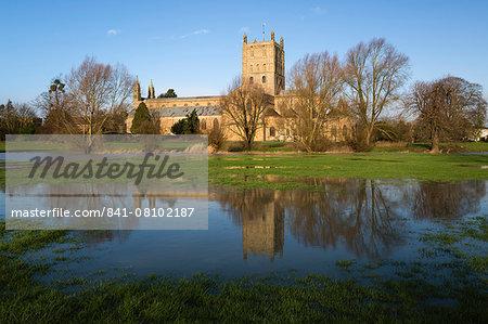 Tewkesbury Abbey reflected in flooded meadow, Tewkesbury, Gloucestershire, England, United Kingdom, Europe