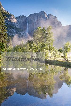 Yosemite Falls reflected in the Merced River at dawn, Yosemite National Park, UNESCO World Heritage Site, California, United States of America, North America