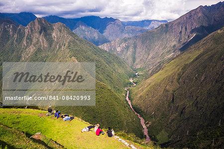 Tourists at Winaywayna Inca Ruins, on Inca Trail Trek day 3, Cusco Region, Peru, South America