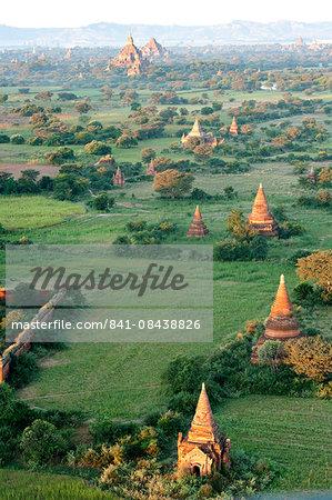 Bagan terracotta temples, Htilominlo temple in the distance, in morning sunshine, seen from the air, Bagan (Pagan), Mandalay Division, Myanmar (Burma), Asia