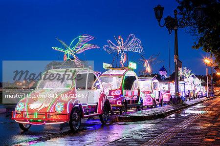 Brightly coloured illuminated pedal cars in Yogyakarta city, Java, Indonesia, Southeast Asia, Asia