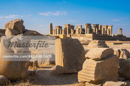 Broken bull column in foreground, Persepolis, UNESCO World Heritage Site, Iran, Middle East