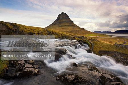 Mountain river with Kirkjufell (Church Mountain) in background, Grundafjordur, Snaefellsnes Peninsula, Iceland, Polar Regions